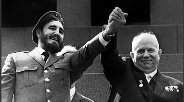 Cuban First Secretary of the Cuban Communist party and President of the State Council Fidel Castro (L) is shown in file photo dated May 1963 holding the hand of Soviet leader Nikita Khrushchev during a four-week offical visit to Moscow. (Image Source: The Windsor Star).